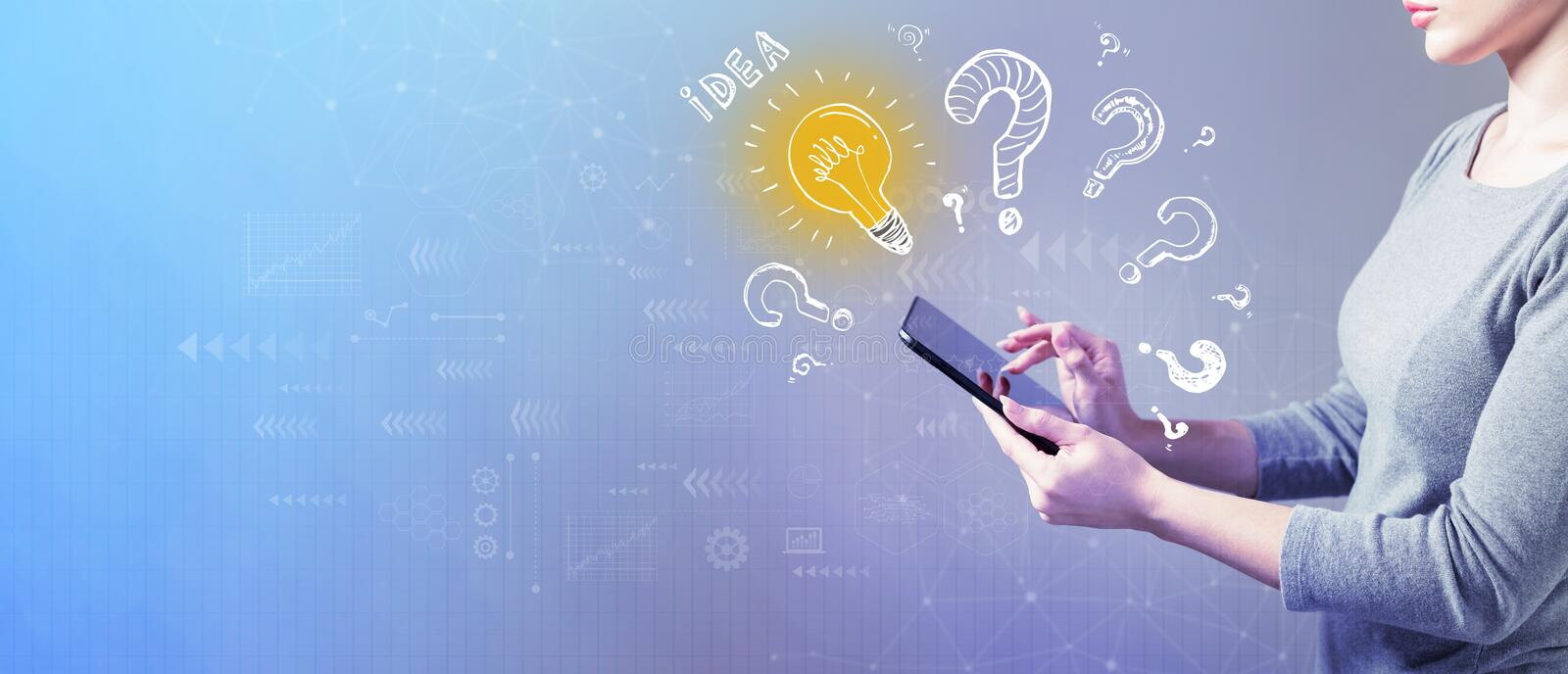 Idea light bulbs with question marks with woman using a tablet stock photography