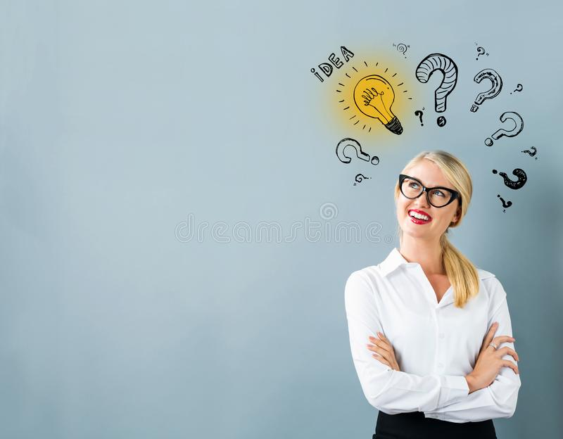 Idea light bulbs with question marks with young woman royalty free illustration
