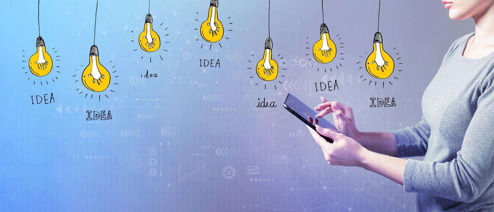 Idea light bulbs with woman using a tablet. Idea light bulbs with business woman using a tablet computer royalty free stock photography