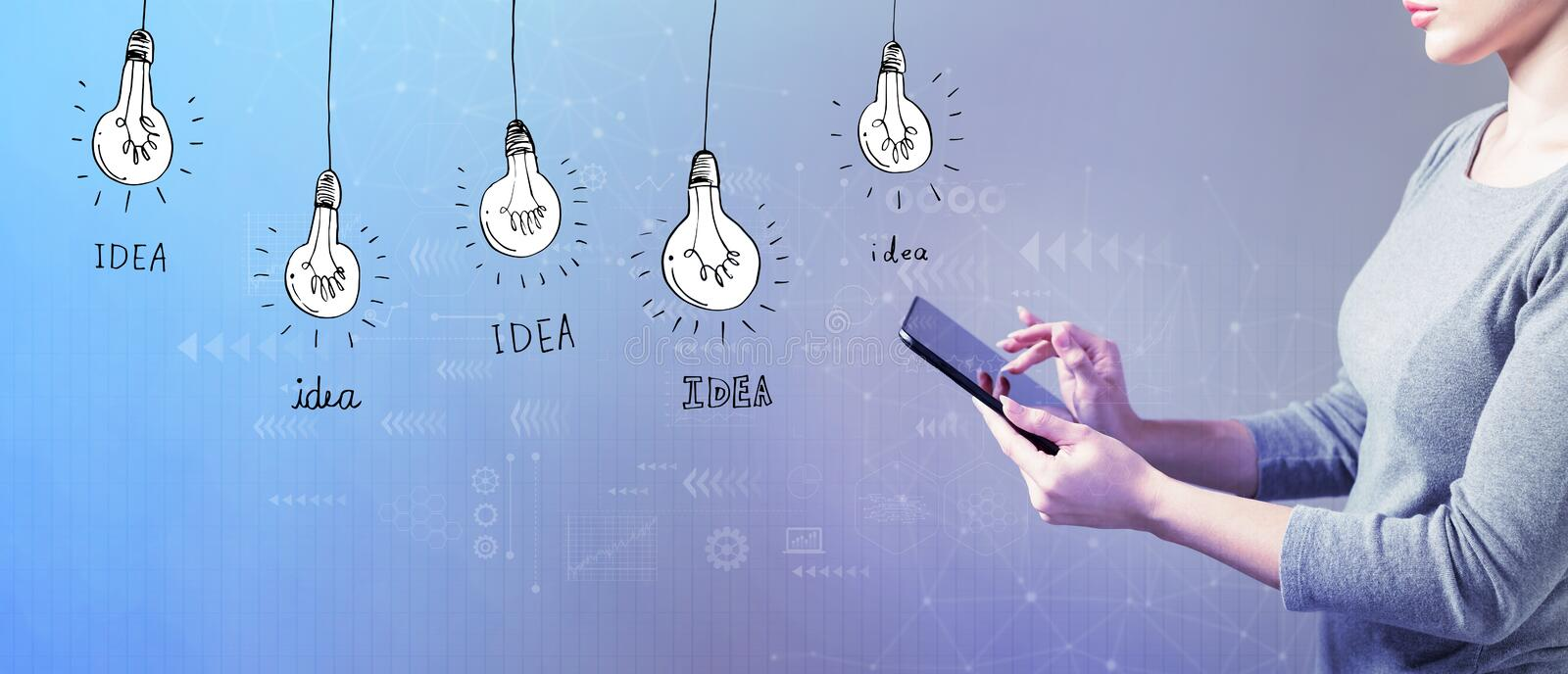 Idea light bulbs with woman using a tablet. Idea light bulbs with business woman using a tablet computer royalty free stock photo