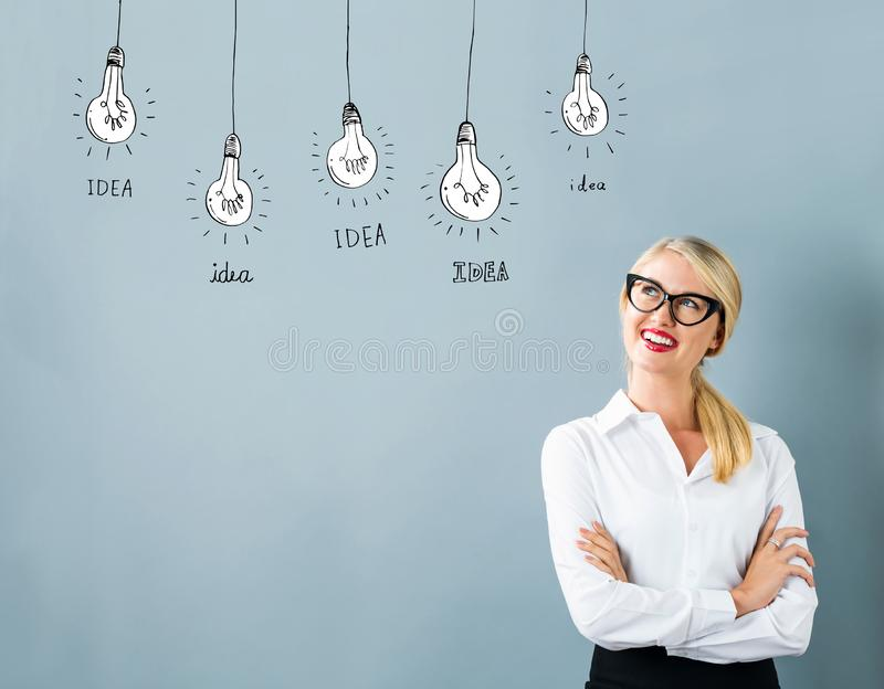 Idea light bulbs with young woman stock photography