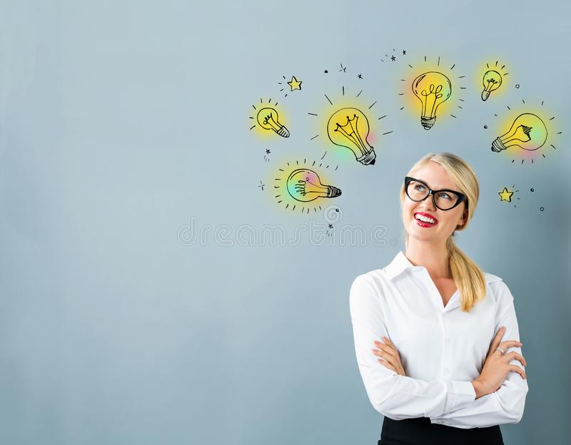 Idea light bulbs with young woman stock illustration