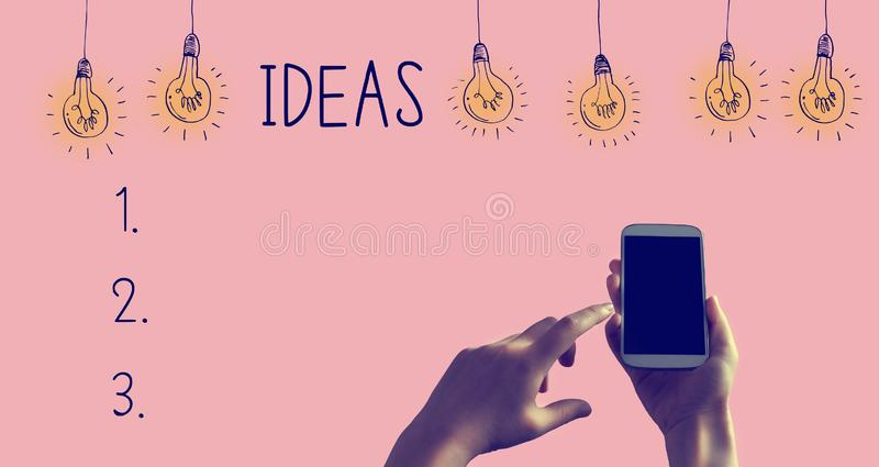 Idea list with smartphone royalty free stock photography