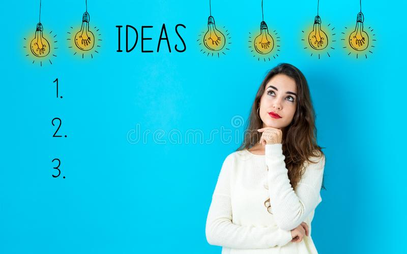 Idea list with young woman stock photos