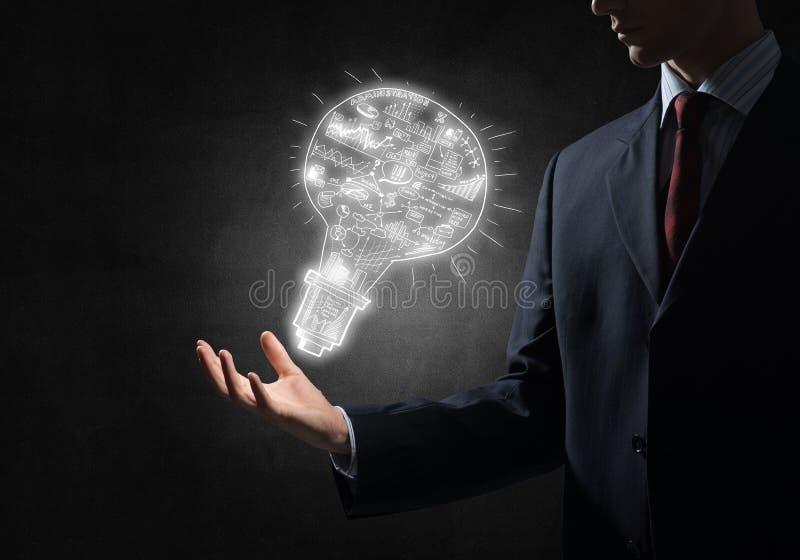 Idea luminosa per il raggiungimento di successo immagine stock