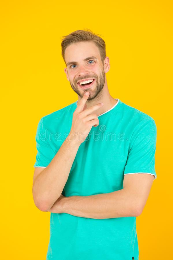 Idea. Male beauty. Barber hairdresser salon. Handsome bearded man. Something on his mind. Handsome man thinking yellow stock photography