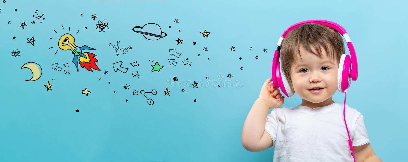 Idea rocket with toddler boy with headphones royalty free stock photos