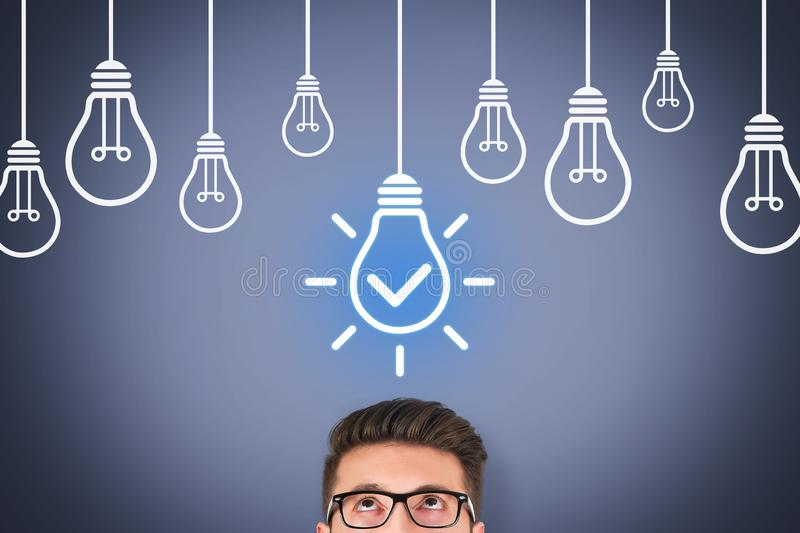 Idea Solution Concepts with Light Bulb on Visual Screen royalty free stock photos