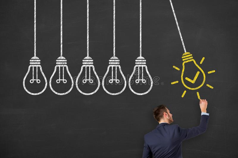 Idea solution concepts with light bulbs on a chalkboard background stock photos