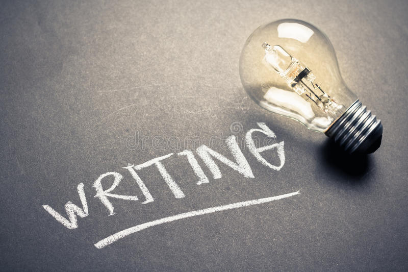 Idea for Writing. Handwriting of Writing word on chalkboard with glowing light bulb royalty free stock photos