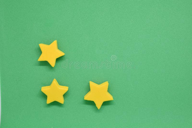 Smooth green single color abstract background with yellow stars on one side for card or web application. Ideal for banner for card or web application Smooth royalty free stock photo