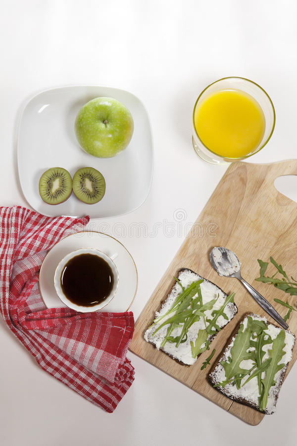 The ideal breakfast for the proper energy for the full day. Coffee with milk, orange juice, fruit . Top view stock photography