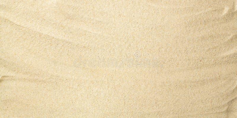 ideal sandtextur f?r bakgrunder Sandig strandbakgrund Lekmanna- l?genhet Top besk?dar arkivbilder