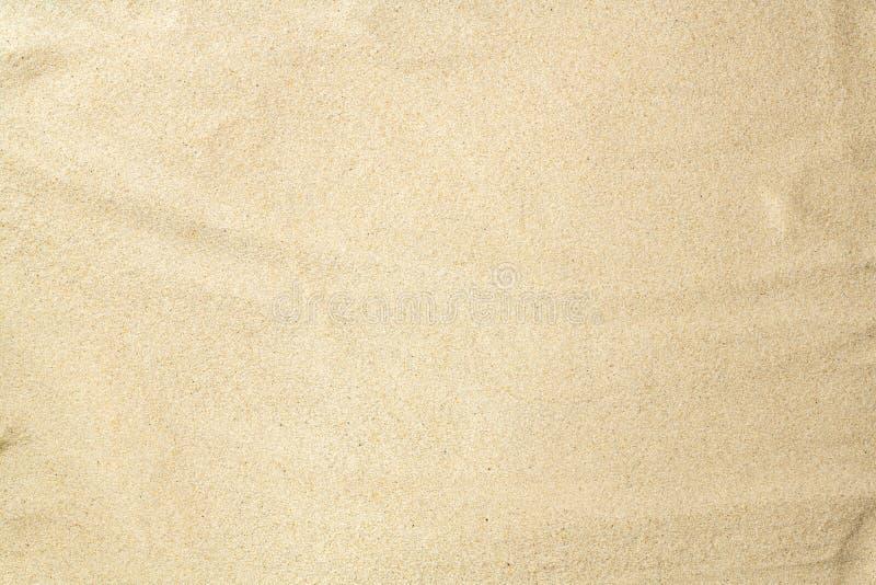 ideal sandtextur f?r bakgrunder Sandig strandbakgrund Lekmanna- l?genhet Top besk?dar royaltyfri fotografi