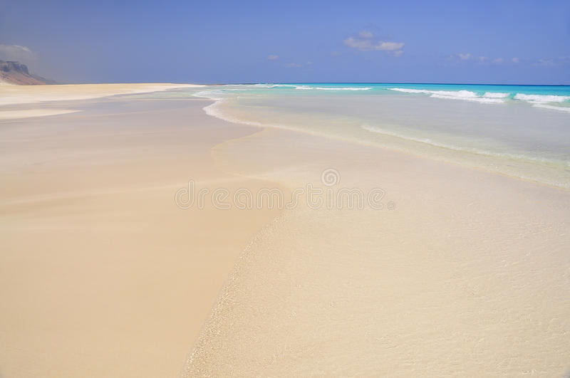 Idealistic deserted beach with emerald clear water. stock photography