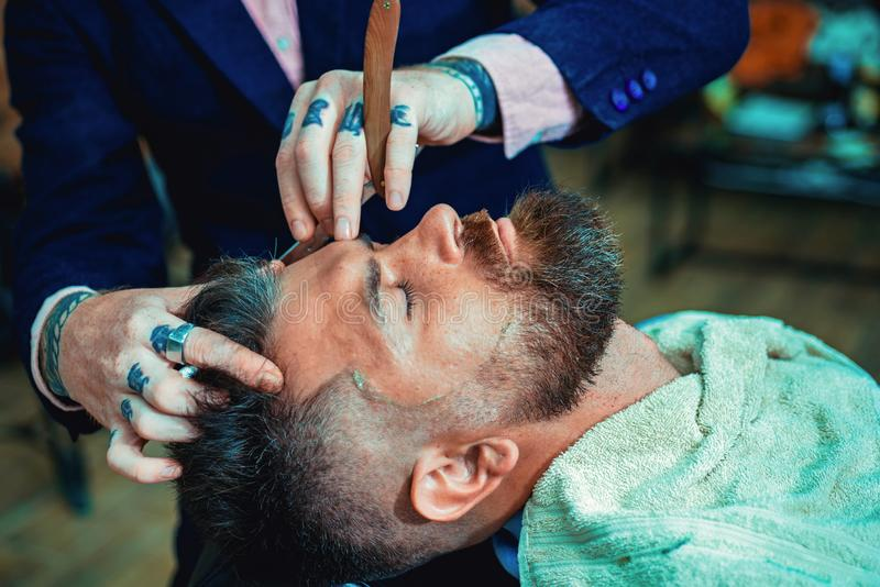 Ideas about Barbershop and Barber salon. Making haircut look perfect in barber shop. Fine Cuts. Professional hairstylist stock photography