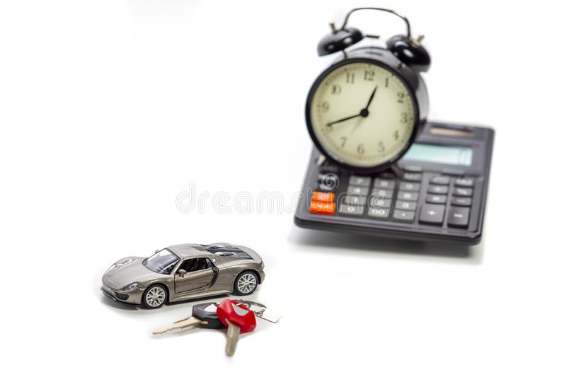 Ideas of Cars Loans and Credits. Composition of Scale Car and Keys against Calculator on Background. Horizontal Image Composition royalty free stock photos