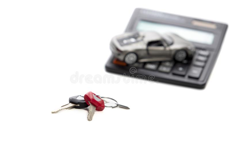 Ideas of Cars Loans and Credits. Composition of Scale Car and Keys. Against Calculator on Background. Horizontal Shot stock photography