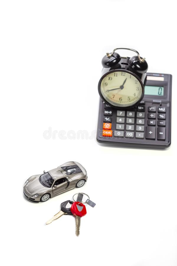 Ideas of Cars Loans and Credits. Composition of Scale Car and Keys against Calculator on Background. Vertical Image stock photos