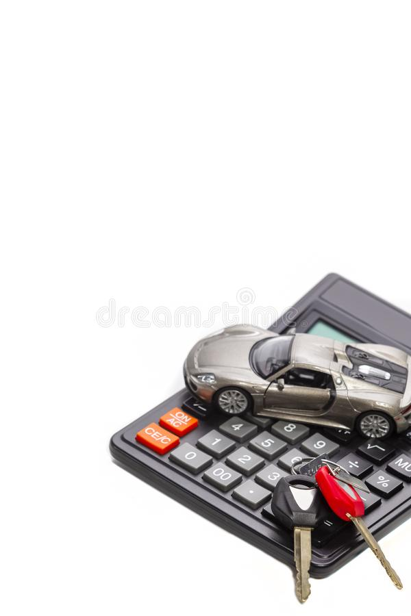 Ideas of Cars Loans and Credits. Composition of Scale Car and Keys against Calculator. On Background royalty free stock photography