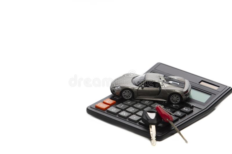 Ideas of Cars Loans and Credits. Composition of Scale Car and Keys against Calculator. On Background. Horizontal Image stock photography