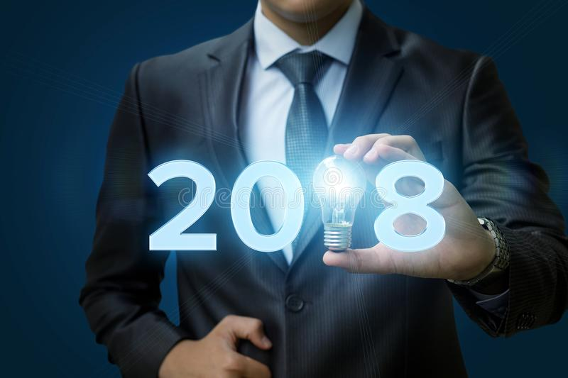 2018 Ideas concepts with businessman hand holding light bulb. stock image