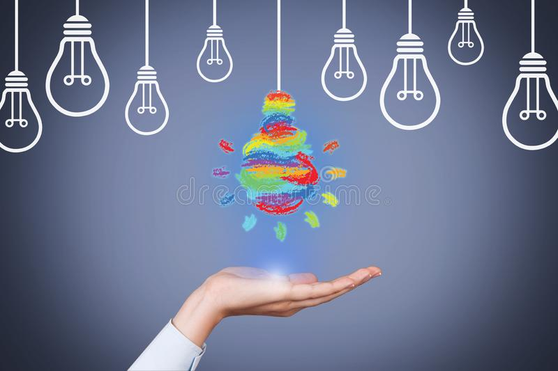 Ideas Creative Concepts with Light Bulb over Human Hand stock photos