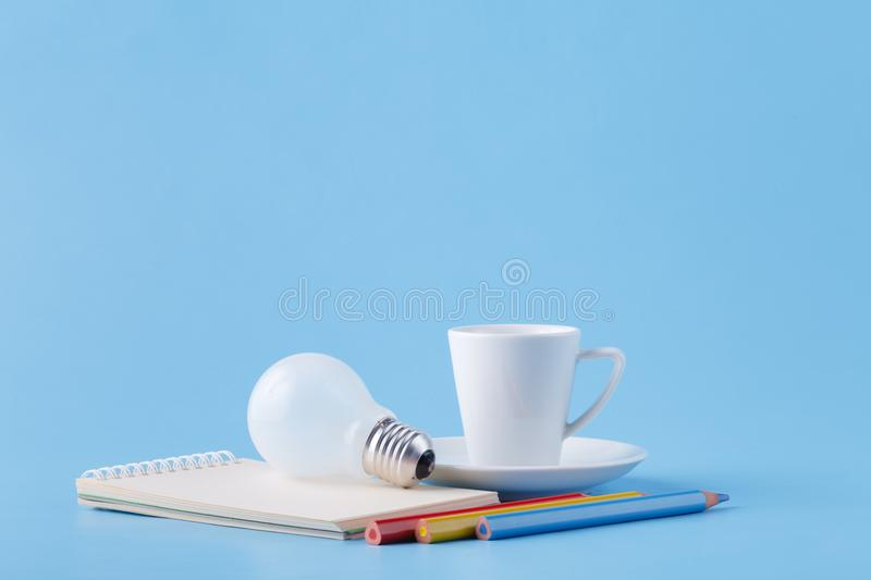 Ideas and energy for artist, coffee, light bulb and colour pencils stock image