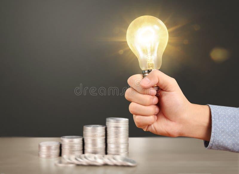 Ideas, energy saving light bulb stock photography