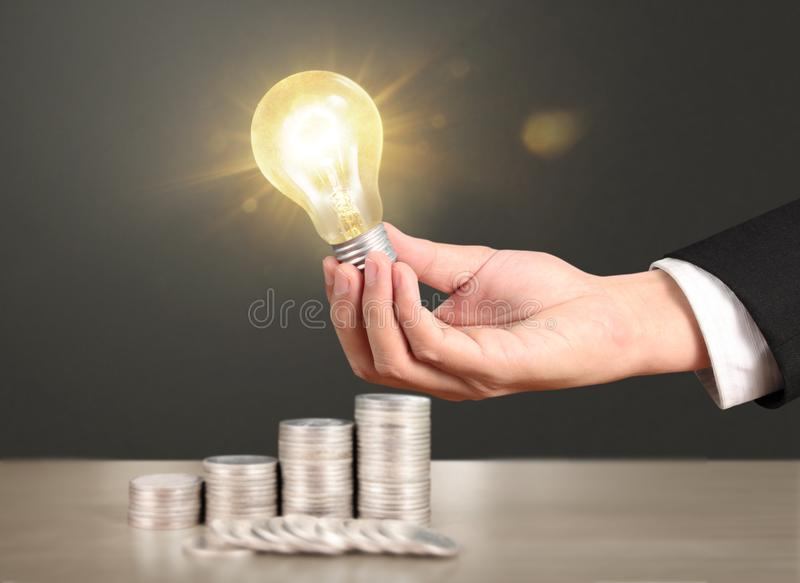Ideas, energy saving light bulb royalty free stock image