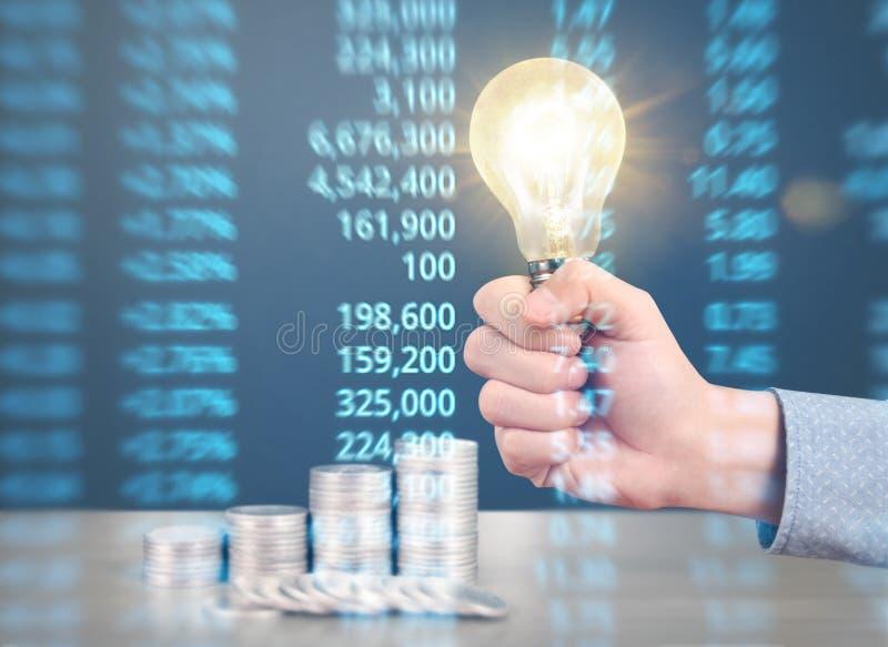 Ideas, energy saving light bulb stock photo