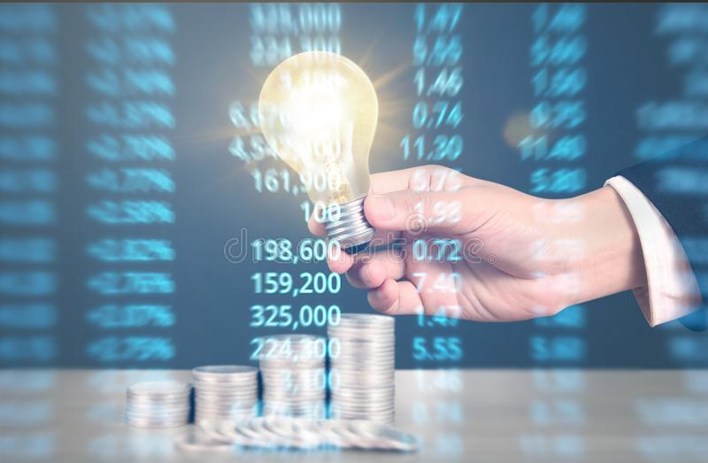 Ideas, energy saving light bulb stock image