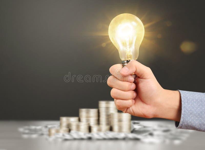 Ideas, energy saving light bulb royalty free stock photo