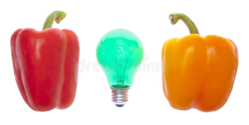 Ideas About Food. Light Bulb with Fresh Peppers for Ideas about Food and Creativity Concepts. Isolated on White with a Clipping Path royalty free stock image