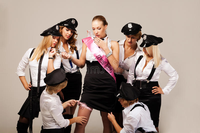 Ideas for hen party: find the garter. Party mates found fiancée's garter royalty free stock photo