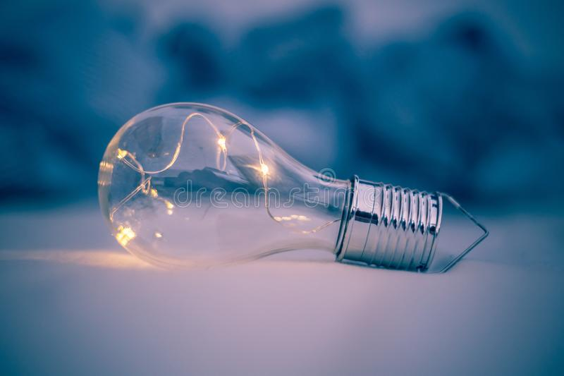 Ideas and innovation: Light bulb with LEDs is lying in the bed. LED light bulb is lying in the bed. Symbol for ideas and innovation power technology object royalty free stock photography