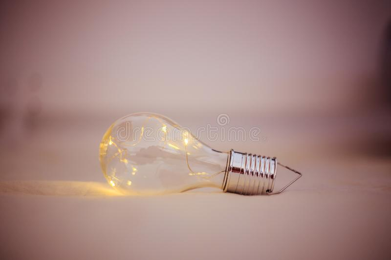 Ideas and innovation: Light bulb with LEDs is lying in the bed. LED light bulb is lying in the bed. Symbol for ideas and innovation power technology object royalty free stock photos