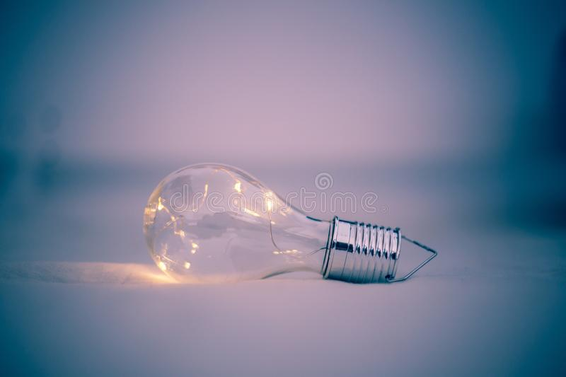 Ideas and innovation: Light bulb with LEDs is lying in the bed. LED light bulb is lying in the bed. Symbol for ideas and innovation power technology object royalty free stock photo
