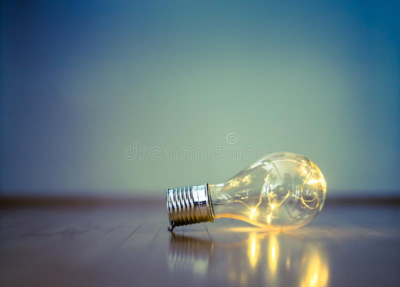 Ideas and innovation: Light bulb with LEDs is lying on the wooden floor. Copy space. LED light bulb is lying on the wooden floor. Symbol for ideas and innovation stock photo