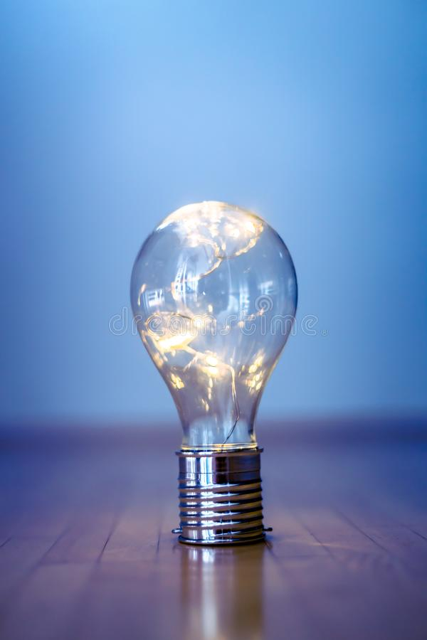 Ideas and innovation: Light bulb with LEDs is lying on the wooden floor. Copy space. LED light bulb is lying on the wooden floor. Symbol for ideas and innovation stock image