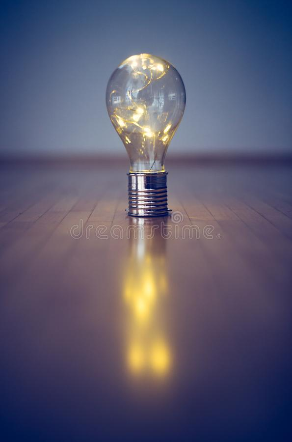 Ideas and innovation: Light bulb with LEDs is lying on the wooden floor. Copy space vector illustration