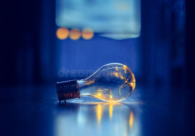 Ideas and innovation: Light bulb with LEDs is lying on the wooden floor. Window and light in the blurry background. LED light bulb is lying on the wooden floor stock photography