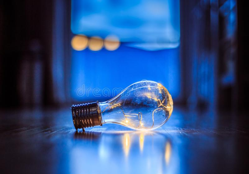 Ideas and innovation: Light bulb with LEDs is lying on the wooden floor. Window and light in the blurry background. LED light bulb is lying on the wooden floor stock images