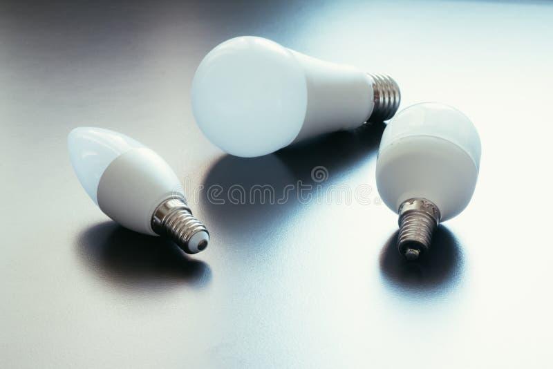 Ideas and innovation: light bulb lying on a desk. White light bulb lying on a desk, concept for ideas innovation power technology object creativity creativeness stock photos