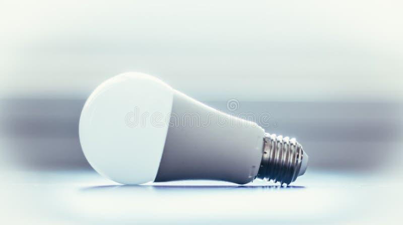 Ideas and innovation: light bulb lying on a desk. White light bulb lying on a desk, concept for ideas innovation power technology object creativity creativeness royalty free stock photos