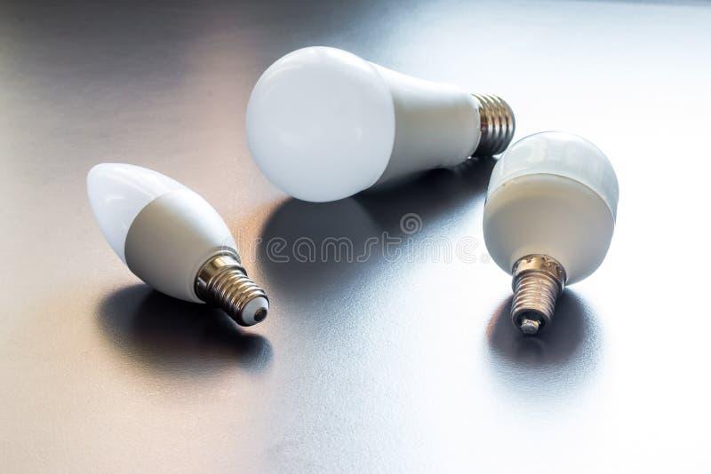 Ideas and innovation: light bulb lying on a desk. White light bulb lying on a desk, concept for ideas innovation power technology object creativity creativeness stock image
