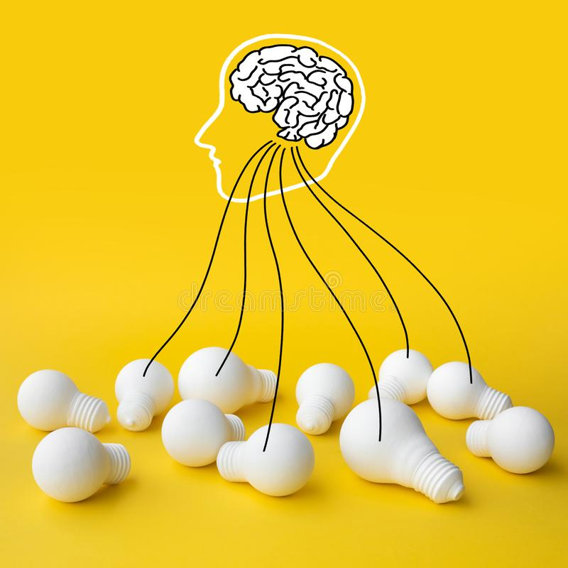 Ideas inspiration concepts with brain in head and group of lightbulb on pastel color background.Business creativity stock images