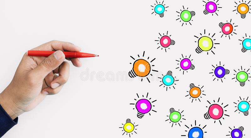 Ideas inspiration concepts with hand using pen drawing colorful lightbulb on white background royalty free stock image
