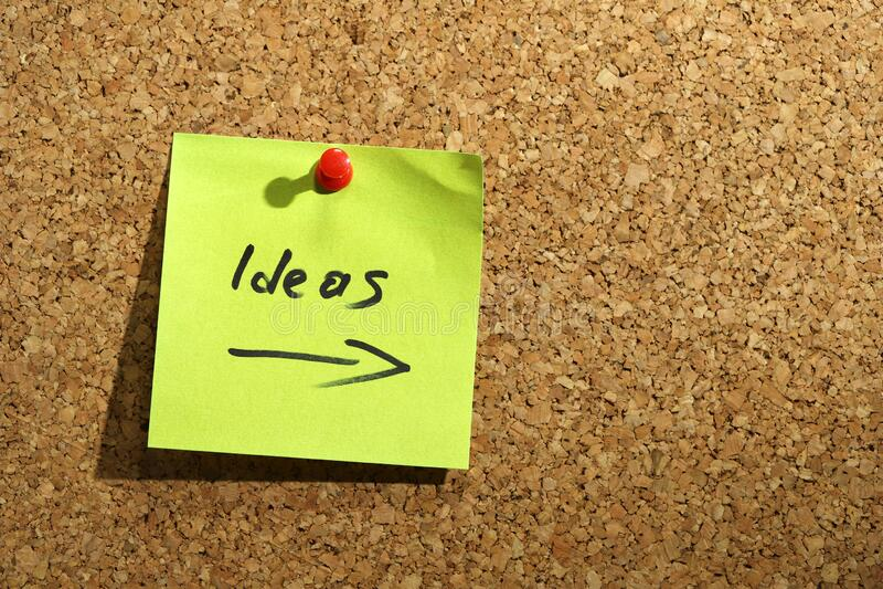 Ideas post it. On corkboard royalty free stock photos