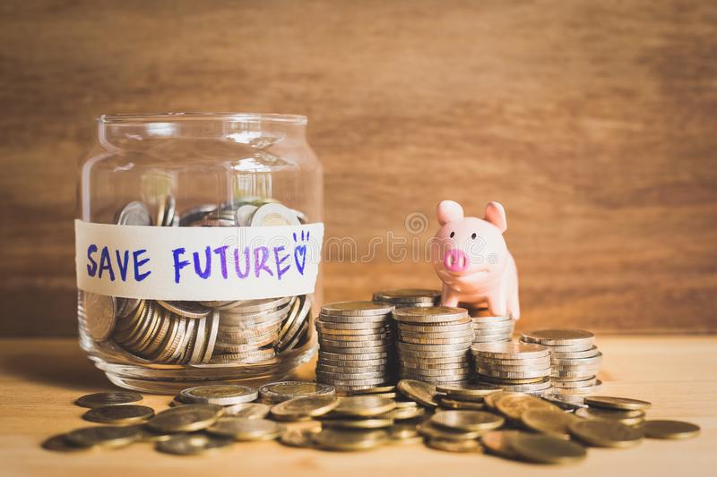 Idea of save money for the future with coins and piggy bank,The strong life of success. Ideas of saving money for the future with coins and piggy bank,The strong stock photo